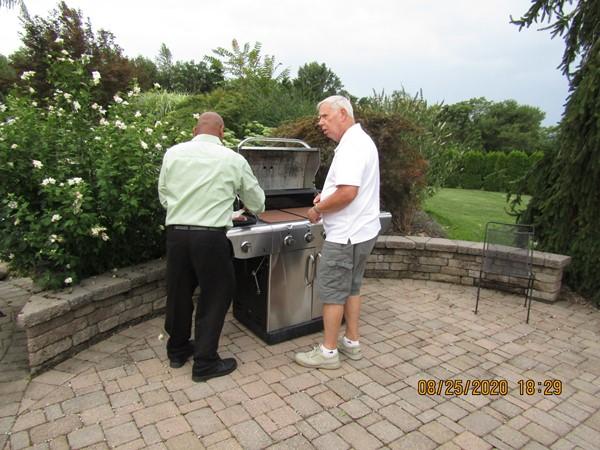 Lion John Aulls preparing to fix the hot dogs. Image